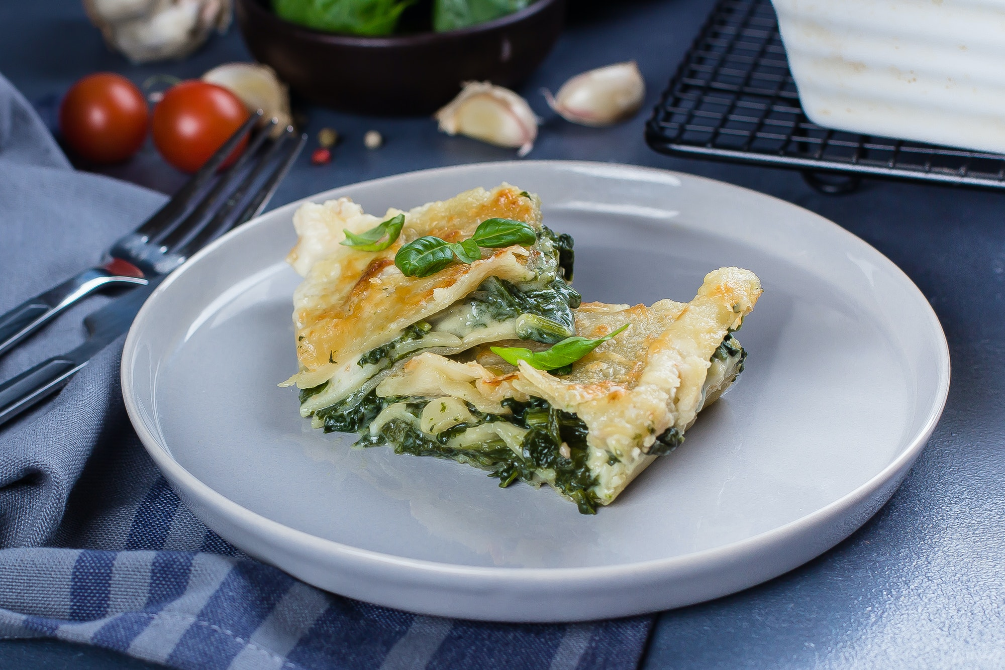 Delicious homemade lasagne with ricotta cheese and spinach on table . Vegetarian Food. Italian Food