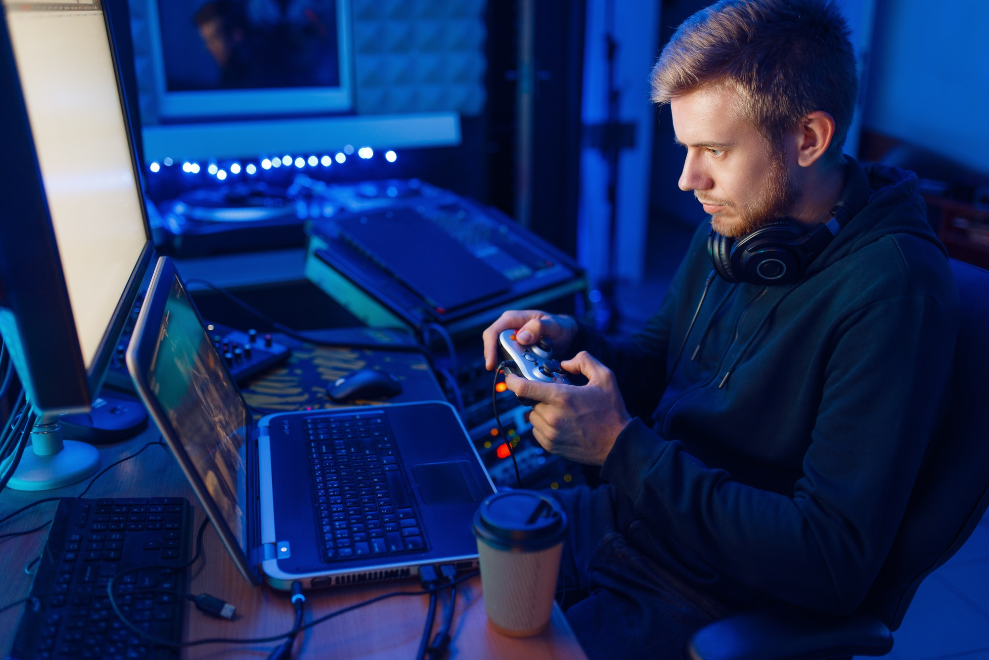 Gamer with joystick playing videogame on console