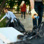 Volunteers picking trash in park, volunteering