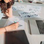 cropped view of illustrator drawing storyboard sketches in studio