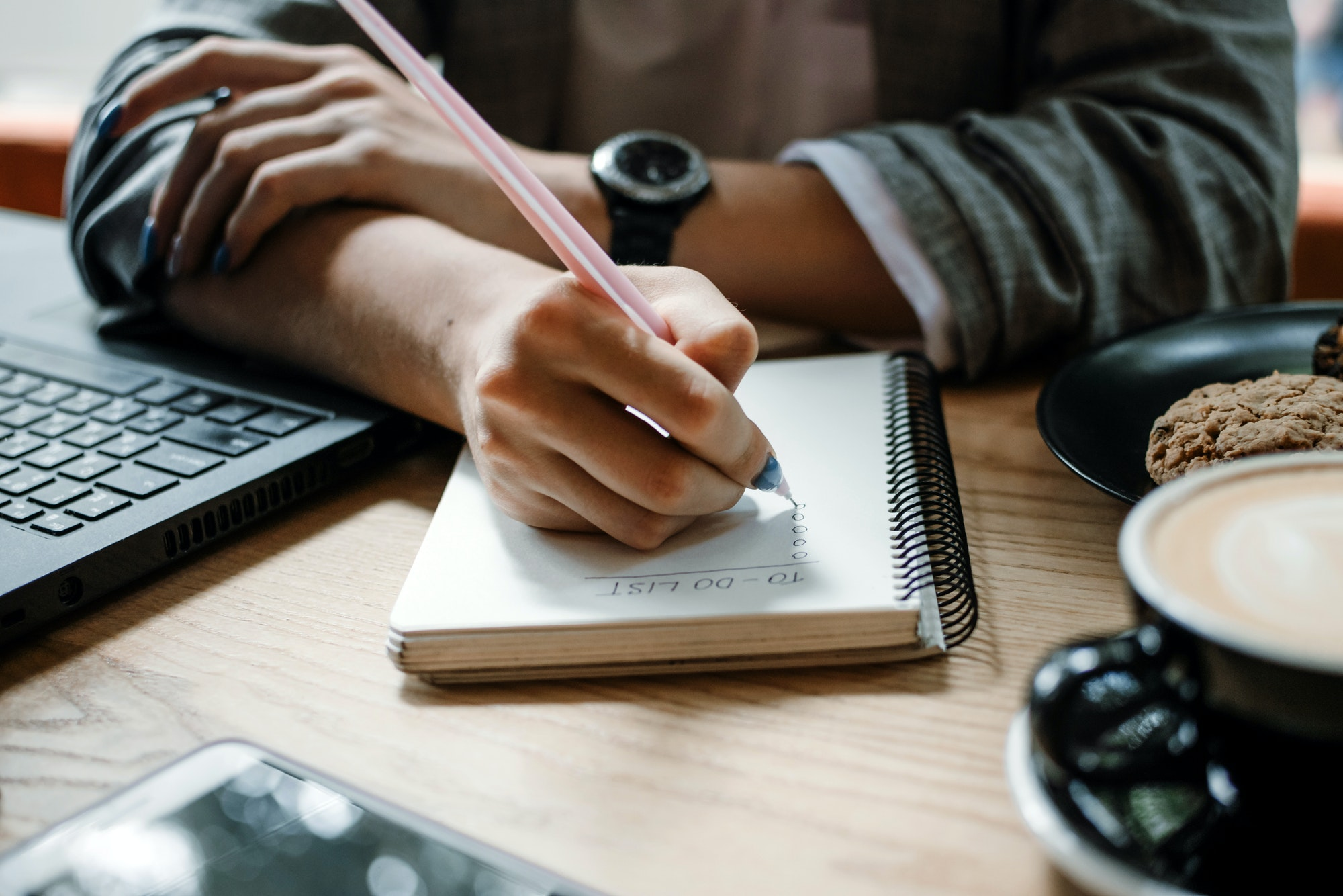 To do list, organize plans, projects, checklist, Productivity Works. Woman writing to do list. Close