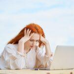 Coronavirus outbreak. Woman reading news about coronavirus and getting anxiety