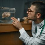 Psychiatrist holds container with the human brain