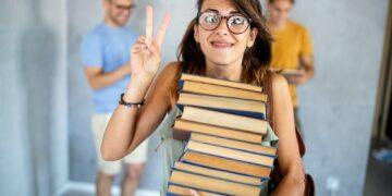 Stylish nerd girl with many books. Education, study, people, university concept