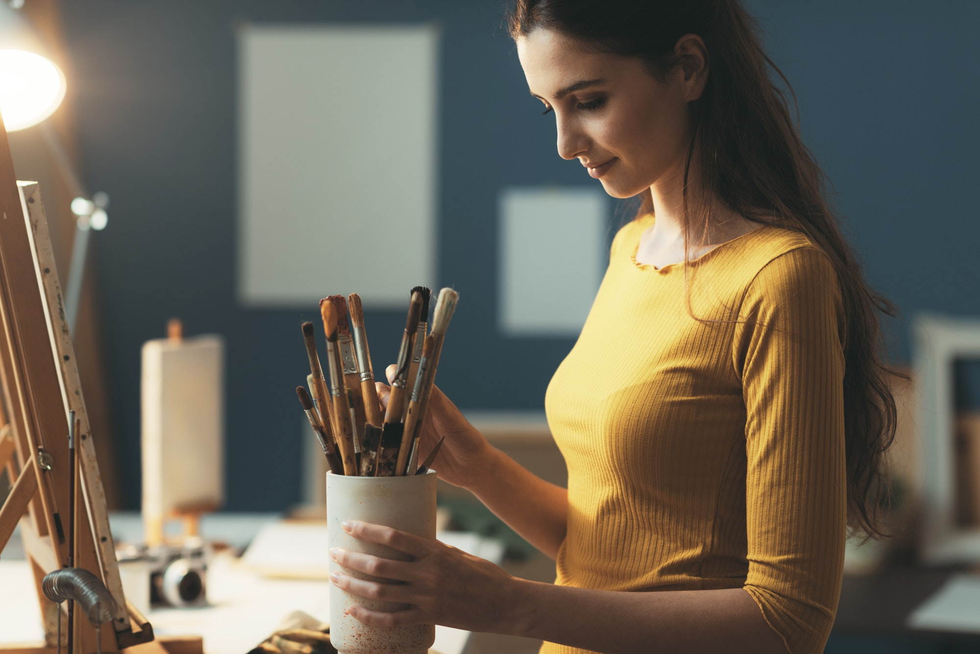 Woman choosing the brushes for her artwork
