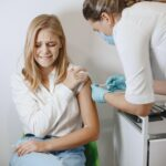 Woman doctor gives a vaccine to patients