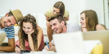 Group of young students studying