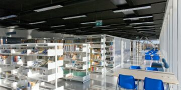 Public Library Interior, modern building with book shelves