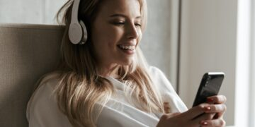 Smiling young woman in headphones