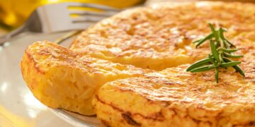 Spanish omelette with potatoes and onion, typical Spanish cuisine. Tortilla espanola