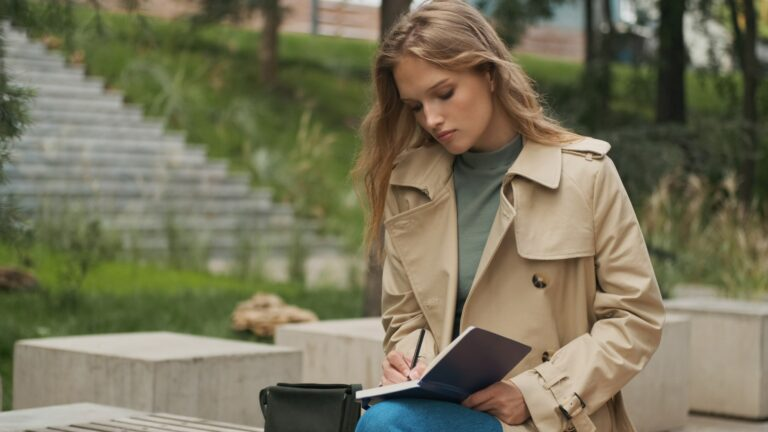 Student girl looking concentrated doing homework for college on