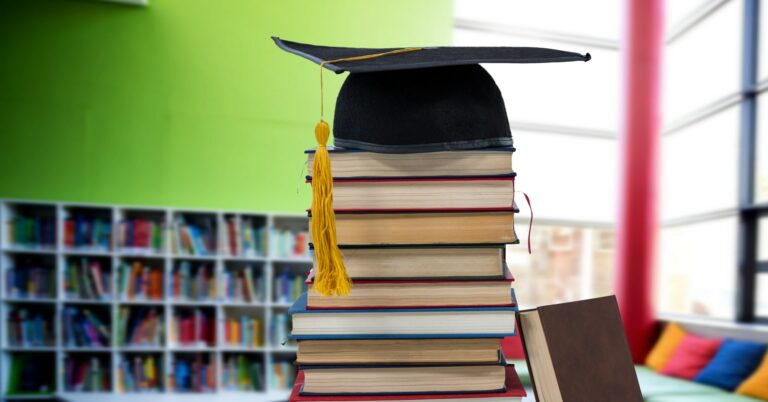 Books and graduation hat in education library