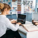 Female student at the laptop in university library