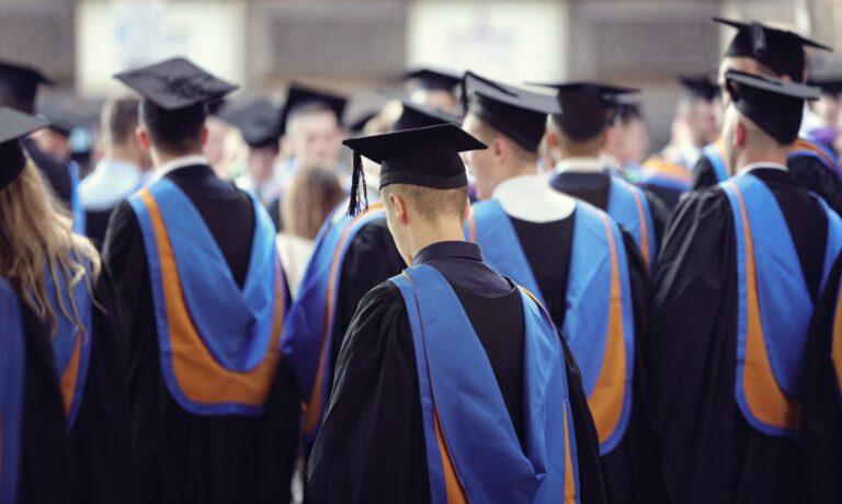 University graduates at graduation ceremony