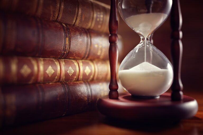 Old books and hourglass