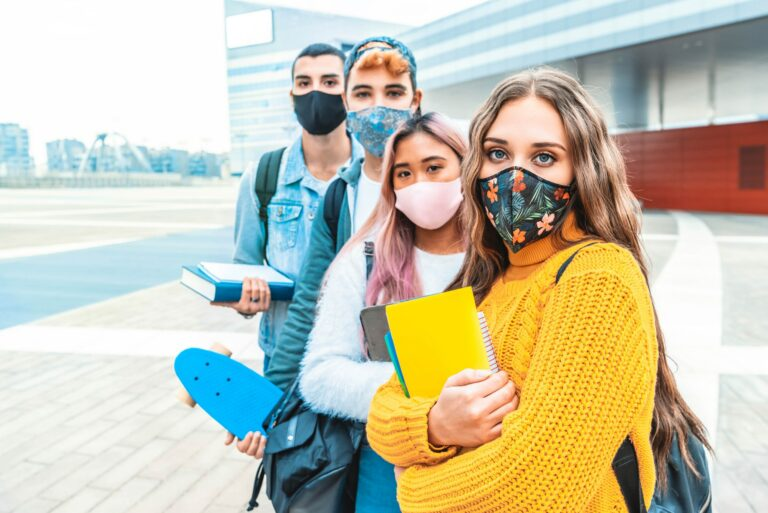 Portrait of a group of students covered by face masks.