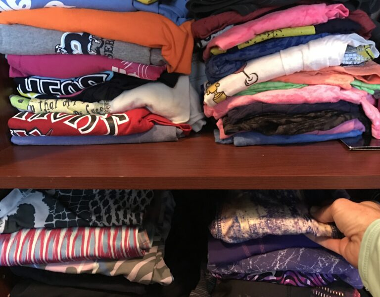 Shelves of shirts in a closet