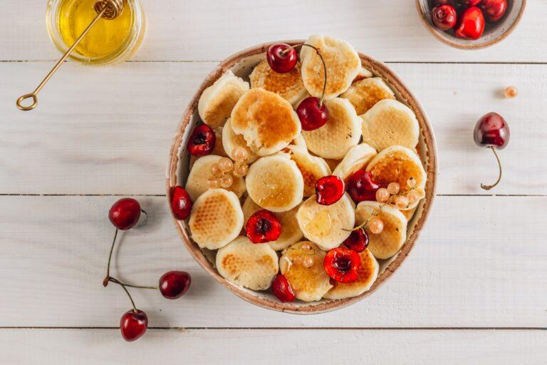 tiny pancakes in a ceramic bowl