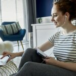 Cheerful woman learning at home online