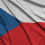 Czech flag is depicted on a sports cloth fabric with many folds. Sport team waving banner