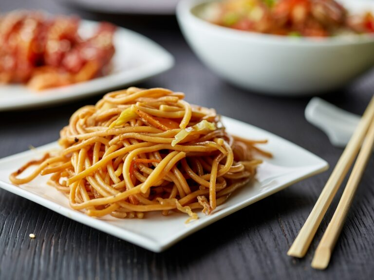 plate of fried noodles with vegetables