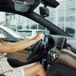 Female driver inside of modern automobile. Testing brand new car