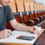 Man student in empty classroom
