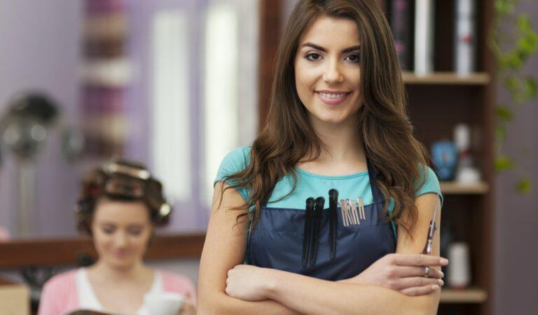 Portrait of smiling owner of hairdresser salon